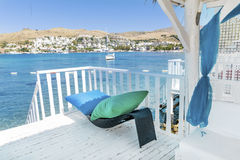 Over water  wooden bungalow with rattan sunbed and pillows Royalty Free Stock Images
