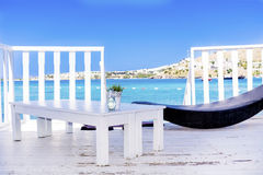 Over water  wooden bungalow with sunbed and table on a sea view Stock Photography