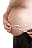 Over weight male with measuring tape. Obese male with measuring tape around stomach Stock Photos