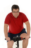 Over weight men Cycling Stock Photography