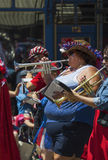 Over weight woman plays trumpet July 4, Independence Day Parade, Telluride, Colorado, USA Royalty Free Stock Photo