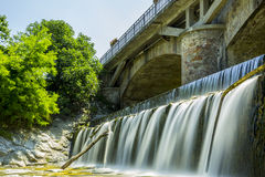 Over the Weir, Under the Bridge. Royalty Free Stock Image