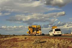 Over width truck heading into, a storm approaching. royalty free stock photos