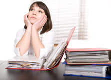 Over-worked. Young adult over-worked woman at desk stock image