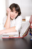 Over-worked. Young adult over-worked woman at desk Stock Photos