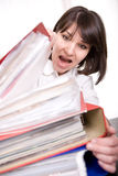 Over-worked. Young adult over-worked woman at desk Stock Photography