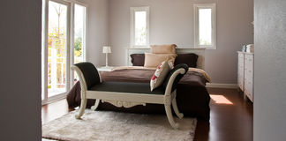 Overall bedroom. With white bed and brown sheet Stock Images