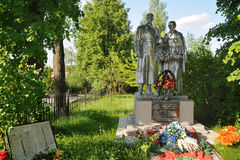 Overall view of Common Burial in Anosino in Summer with Flowers. Overview war memorial in the village Anosino in Istra district of Moscow region with a lot od Royalty Free Stock Images
