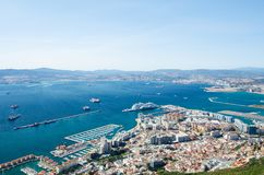 Overall view from top of the Rock of Gibraltar city, cruise port and marina, airport runway, Gibraltar Bay or Bay of Algeciras. Overall view from top of the Royalty Free Stock Photography