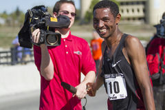 Overall winner Belete Assefa after talking to reporters at Bloomsday 2013 Royalty Free Stock Images