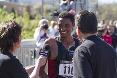 Overall winner Belete Assefa talks to reporters after winning Bloomsday 2013 Stock Photo