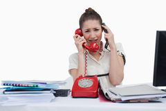 Overbooked businesswoman answering the phones Royalty Free Stock Photography