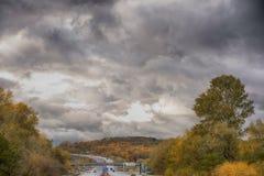 Overcast autumn day. Asphalt road on a overcast autumn day royalty free stock photography
