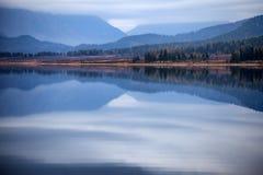 Overcast autumn morning on a mountain lake Royalty Free Stock Photo