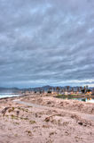 Overcast clouds rolling over beach park. Stock Photos