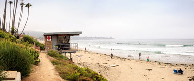 Overcast cloudy day over the first aid lifeguard station at Scri. Pps Beach in La Jolla, California at the end of Summer stock photos