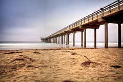Overcast cloudy day over Scripps pier Beach in La Jolla Royalty Free Stock Photography