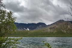 Overcast cloudy sky over the lake and mountains Khibiny. Overcast cloudy sky over the lake and mountains Khibiny Royalty Free Stock Photography