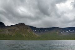 Overcast cloudy sky over the lake and mountains Khibiny.  Stock Image