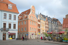 An overcast day in May in the old Riga. People walk on a tourist part of Riga Royalty Free Stock Photos