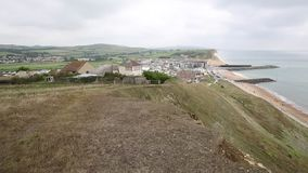 Overcast day West Bay uk Jurassic coast Dorset view to the east stock video footage