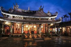 Dalongdong Baoan Temple on rainy night Tapei Taiwan. Overcast evening at Dalongdong Baoan Temple also known as the Taipei Baoan Temple is a Taiwanese folk stock image