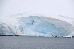 Overcast, glaciers falling into the sea Royalty Free Stock Photo