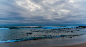 Overcast and Moody Daybreak Seascape. Taken at MacMasters Beach, Central Coast, NSW, Australia on the Bouddi Peninsula Royalty Free Stock Images