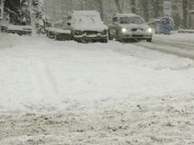 Overcast. Natural disasters winter, blizzard, heavy snow paralyzed city car roads, collapse. Snow covered cyclone royalty free stock photography