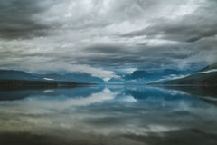 Overcast skies reflected in a calm lake. Royalty Free Stock Photos