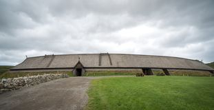 Lofotr Viking museum reconstructed longhouse with dramatic cloudy sky. stock photography