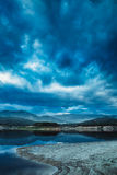 Overcast sky lake. Overcast sky and mountain lake reflection in the water Stock Photography