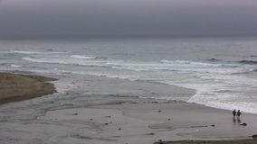 Camera Pan Ocean Waves On Northern California Beach With Distant View Of Couple stock video
