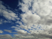 Overcast smooth clouds texture on blue day sky background Stock Photo
