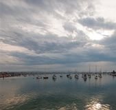 Overcast Sunrise over Newport Beach Harbor in southern California USA. Overcast Sunrise over Newport Beach Harbor in southern California United States royalty free stock image