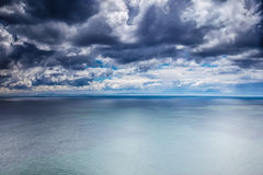 Overcast weather over sea. Dark dramatic cloudy sky, dangerous seascape, panoramic landscape stock photography