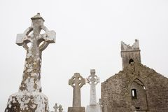 Irish christian graveyard, tomb stones with old church ruin Stock Images