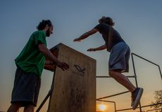 Overcome obstacles with jumps. Bergamo Italy October 12th 2018:Parkour `physical activity in running, climbing and jumping to overcome an obstacle royalty free stock photography