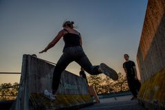 Overcome obstacles with jumps. Bergamo Italy October 12th 2018:Parkour `physical activity in running, climbing and jumping to overcome an obstacle royalty free stock photo
