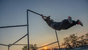 Overcome obstacles with jumps. Bergamo Italy October 12th 2018:Parkour `physical activity in running, climbing and jumping to overcome an obstacle stock photo