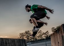 Overcome obstacles with jumps. Bergamo Italy October 12th 2018:Parkour `physical activity in running, climbing and jumping to overcome an obstacle royalty free stock photos