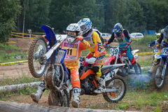 Overcome obstacles. MOSCOW, RUSSIA - SEPTEMBER 10, 2016: An unidentified riders, class `MOTO`, participates in the 4 stage of the XSR-MOTO.RU Cross Country in stock image
