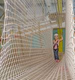 Overcomes obstacles mesh, the adventure Park the kid in the whit Royalty Free Stock Photography