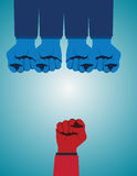 Overcoming adversity and conquering challenges as a group. Of blue fist gloves ganging up on a single red fist as a business symbol of difficult competition Royalty Free Stock Images