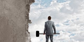 Overcoming challenges. Determined businessman with big hammer in hands Stock Image