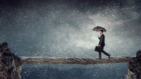 Overcoming the difficulties. Mixed media Stock Photography