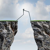 Overcoming. An obstacle concept as a businessman with very long legs walking past through two high cliffs as a success bridge metaphor to surmount an Stock Photo