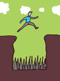 Overcoming obstacles with high risk. Guy jumping over dangerous pit Stock Photo