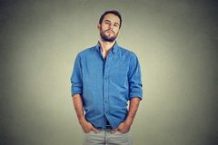 Overconfident man in blue shirt royalty free stock image