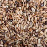 Overcooked peeled sunflower seeds. Background Stock Photos
